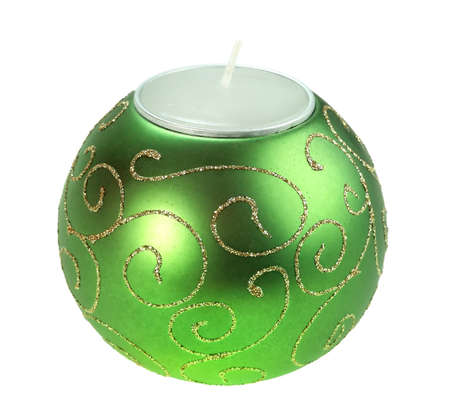 Souvenir Christmas candle as a sphere form. Isolated on white background. Close-up. Studio photography. photo