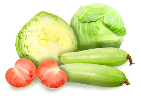 Heap of fresh green cabbage, marrow and red tomatos. Placed on white background. Close-up. photo
