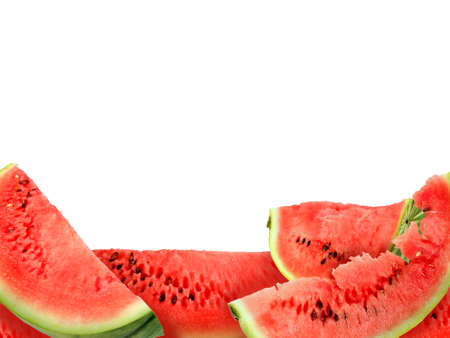 water melon: Abstract background with heap of fresh red watermelons slices. Isolated on white. Close-up. Studio photography.