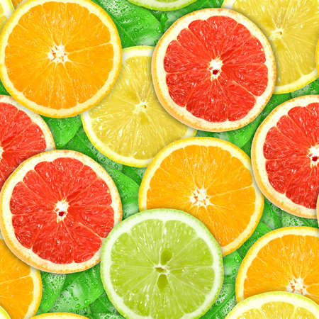 Abstract background with motley citrus-fruit slices and green leaf with dew. Seamless pattern for your design. Close-up. Studio photography. photo