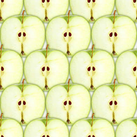 Abstract background with slices of fresh green apple. Seamless pattern for your design. Close-up. photo