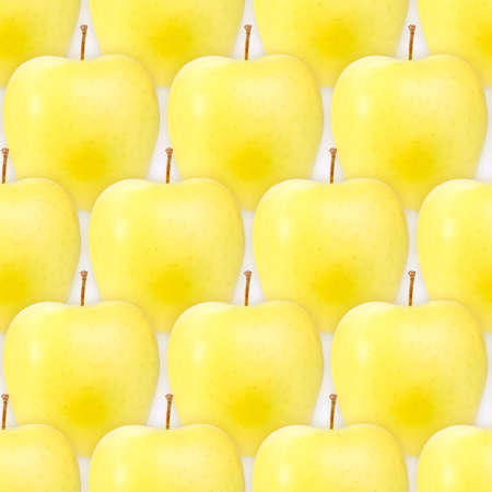 Abstract background of fresh yellow apples. Seamless pattern for your design. Close-up. Studio photography. photo