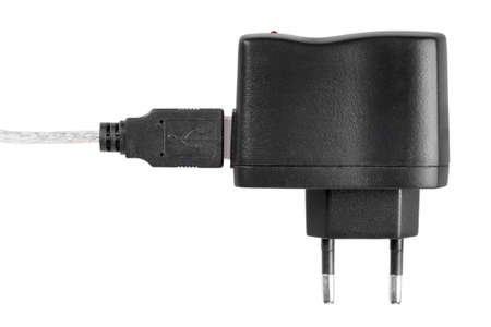 Black AC-DC power supply adapter with USB connector and red LED. Isolated on white background. Studio photography. Stock Photo - 18626439