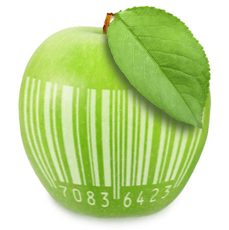 Green apple and one leaf with bar-code symbol. Art design. On white background. photo