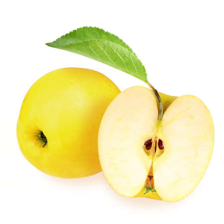 Whole and half of yellow apples with one green leaf on white background. Close-up. Studio photography. photo
