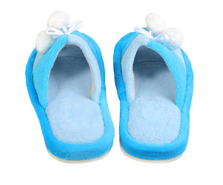 One pair of domestic blue slippers. Back view. Isolated on white background. Close-up. Studio photography. photo