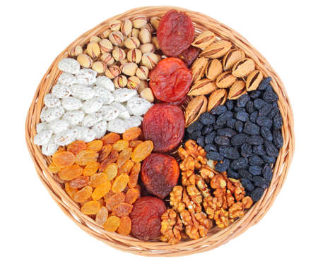 Set of nuts and dry berries in round basket  photo