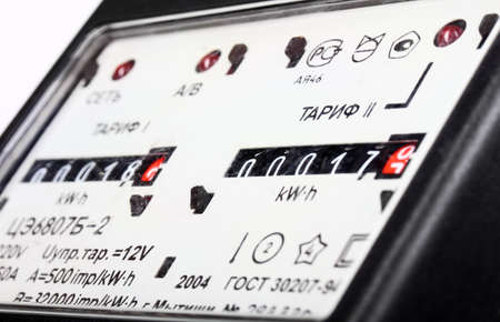 megawatts: Gauge of black mechanical two-tariff electric meter  Studio photography