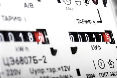 electricity tariff: Gauge of black mechanical two-tariff electric meter  Studio photography