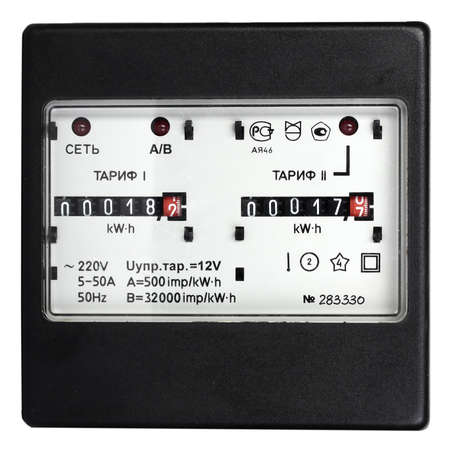 electricity tariff: Black mechanical two-tariff electric meter  Isolated on white background  Studio photography