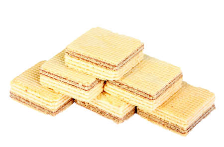 Heap of yellow sweet chocolate waffles. Isolated on white background. Close-up. Studio photography. photo