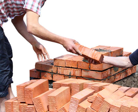Workers laid red bricks. Close-up. Isolated on white background.