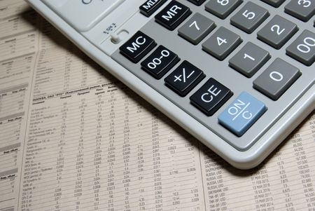 Calculator keypad and financial newspaper. Business concept photo. photo