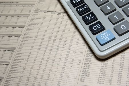 Calculator corner and financial newspaper. photo