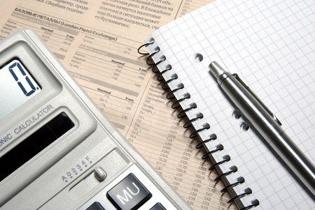 Calculator, pen, notebook and financial newspaper. Conceptual. Stock Photo - 3703696