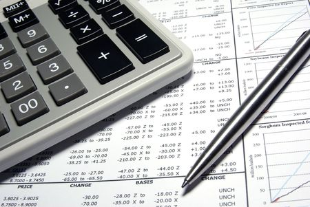 Calculator, steel pen and financial data with graphs. Stock Photo - 3729815