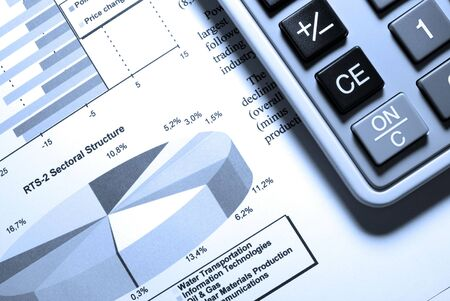 Calculator and printed stock data with diagrams. Stock Photo - 3729822