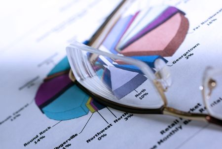 Glasses laying on color diagramm. Financial Concept. Cold photo filter. Stock Photo - 3729810