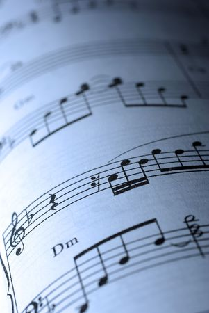 Closeup of musical sheet. Cold photo filter. photo