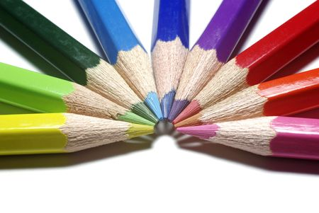 Half-circle of colour pencils isolated on white background. photo