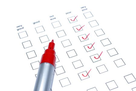 Red marker and survey checklist isolated on white background. photo