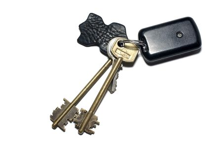 Keys with breloque isolated on white background. photo
