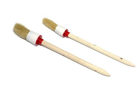 Two round brushes isolated on white background. photo
