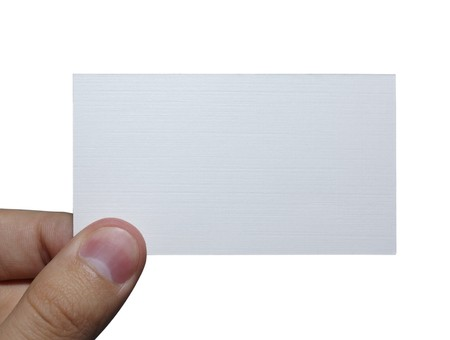 Fingers holding an empty white card isolated on white background. Stock Photo - 3959787