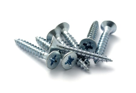 fastening objects: Screws close up photo. Selective focus. Isolated on white background with shadow.