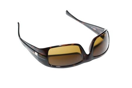 Modern female sunglasses isolated on white background. photo