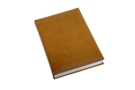 Brown leather book isolated on white background. photo