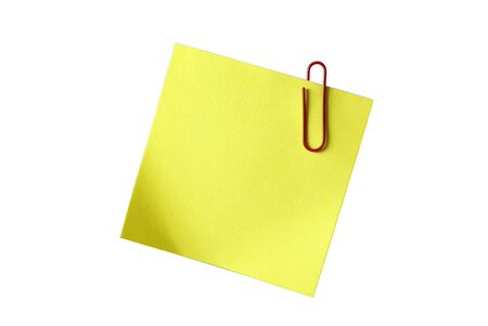Yellow sticky notepaper with red paper-clip isolated on white. Empty space for your design or text. photo