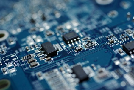 Close up photo of blue PC circuit board. Abstract technology background.