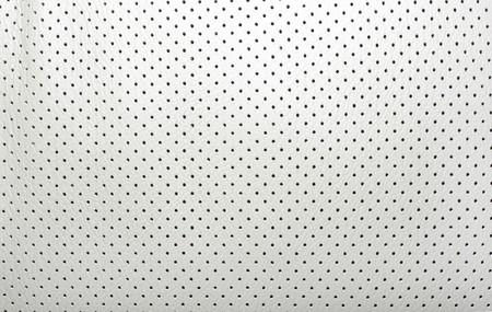 cuero vaca: Alta calidad de cuero perforado de color beige. Interior del coche japonés moderno. Fondo o telón de fondo.