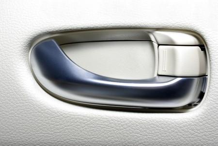 Aluminium door handle of modern japanese car. Abstract background.