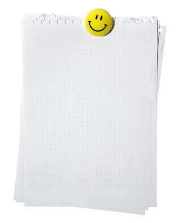 Empty pages from spiral notebook stackes with yellow smiling magnet. Isolated on white background. path.