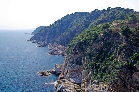 Sea and coastline with rocks. Lloret de Mar, Spain. photo