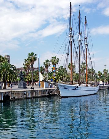 marina life: Big sailboat in Barcelona harbour for romantic travel.
