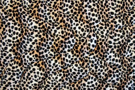 Abstract fabric made leopard cloth as background. photo