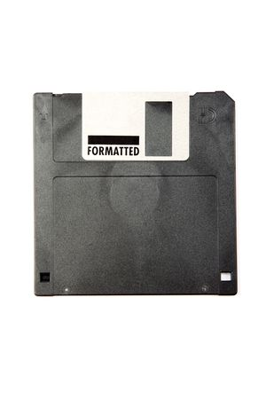 Black obsolete diskette isolated on white background. photo