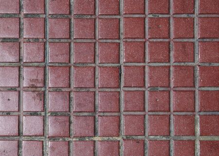 Old red tiled floor. Good as backdrop or background. photo