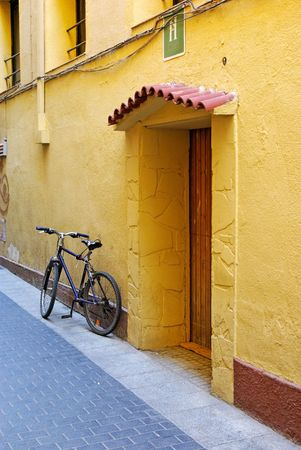 Typical ecological transport near residence building. Lloret de Mar, Spain. photo