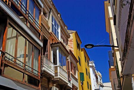 Typical narrow street of Lloret de Mar, Spain. photo