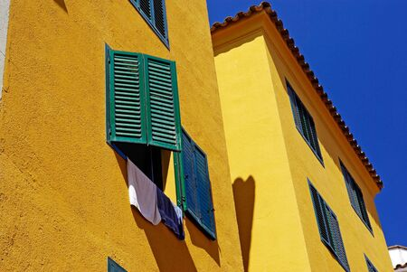 Yellow architecture of small Lloret de Mar city. Costa Brava, Spain. photo