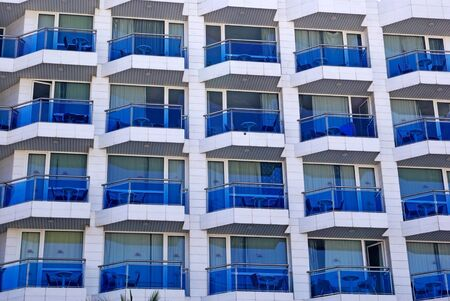 Abstract building with balcony as backdrop or background. photo