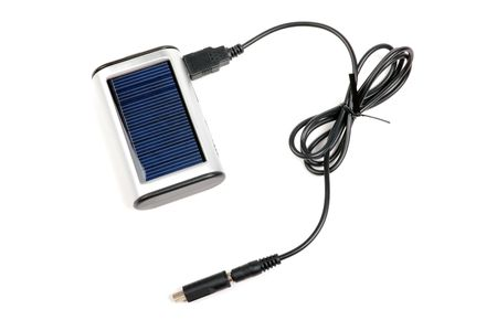 Solar charger for mobile phones isolated on white background.