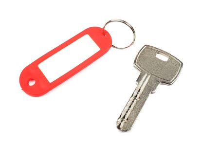 Key and red trinket with empty for your design space isolated on white background. photo