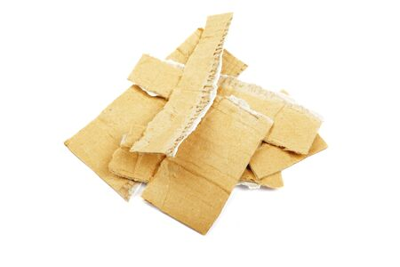Heap of torned cardboard isolated on the white background. photo