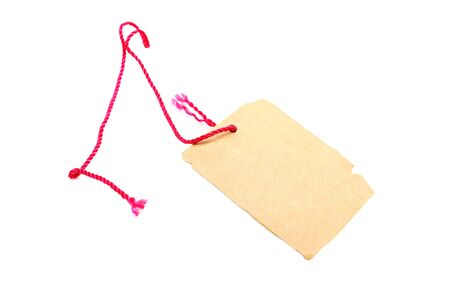 Price tag made of brown cardboard with red rope isolated on white background. Stock Photo - 6902341