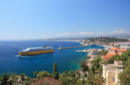 Summer view of the city of Nice and the harbor with crusie ship. photo